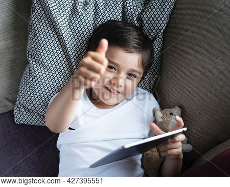 Cheerful Boy Showing Thumb Up, Top View Portrait Child Playing Game Or Watching Cartoon On Tablet, H