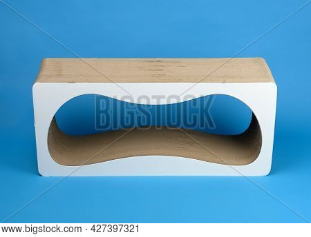 Paper Scratching Post Made Of Corrugated Cardboard On A Blue Background