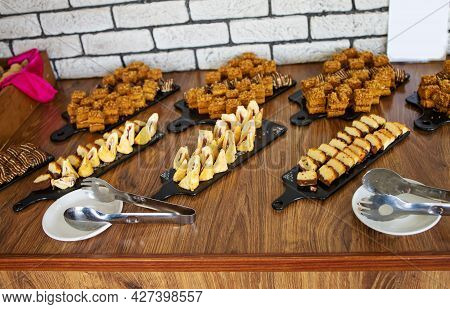 Sweet Banquet Table With Different Sweets In Restaurant