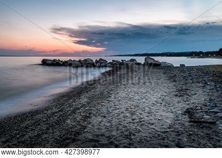 Tropical Beach On Beautiful Sunset. Nature Seascape Background. Sun Setting In Waves Of Aegean Sea I