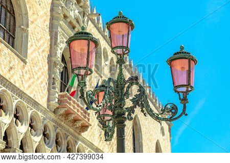 Details Of Venetian Famous Street Lamps Of The San Marco Square In Venice City Downtown. Saint Mark