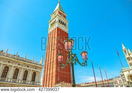 Details Of Venice, San Marco Square Of Venice City. Saint Mark Bell Tower And Its Famous Street Lamp