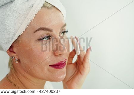 Young Woman In Bath Towel On Head Apply Cleansing Tonic With Cotton Pads. Girl Remove Makeup With Mi