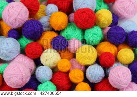 Colorful Background Of Multi-colored Yarn For Knitting,crocheting.many Balls Of Yarn Of All Colors.t