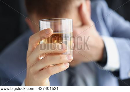 Drunk Sad Man Holds Glass With Alcohol
