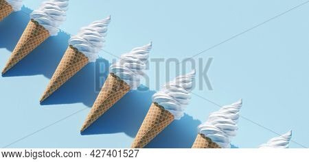 Soft serve ice cream in a cone on blue background
