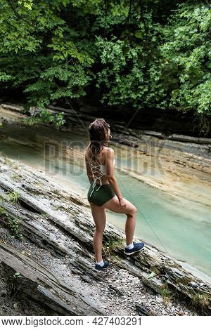 Young Happy Woman Enjoing The Nature, Standing By The Mountain River.