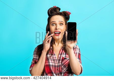 Excited Pinup Lady Showing Smartphone With Blank Screen, Mockup For Website Or Mobile App Design, Bl