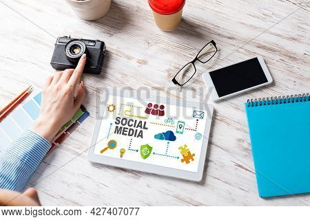 Blogger Sitting At Desk With Tablet Computer And Camera. Mobile Smart Devices In Business Processes.