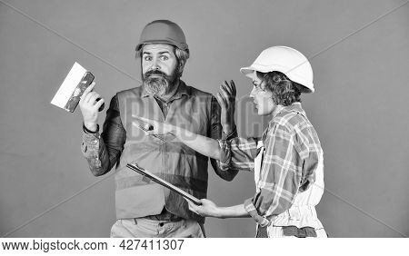 Couple Planning Changes Renovation Apartment. Sign Contract With Workers. Discussing Renovation With