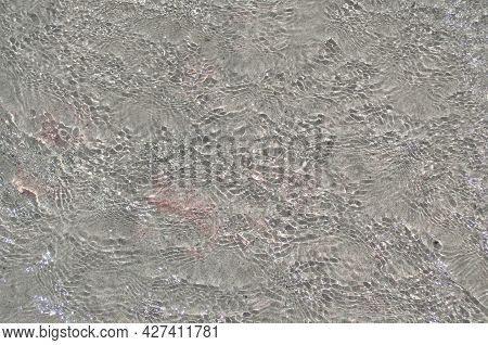 The Surface Of The Sea With Shallow Ripples In Shallow Water As An Abstract Background.