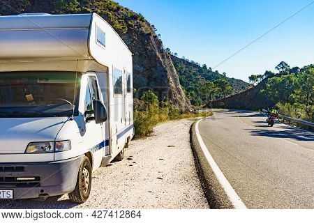 Caravan On Roadside. Road Through Spanish Rocky Mountains From Marbella To Ronda, Andalucia In Spain