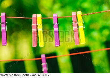 Clips For Washing Laundry Clothes Pegs On String Rope Outdoor. Housework Concept