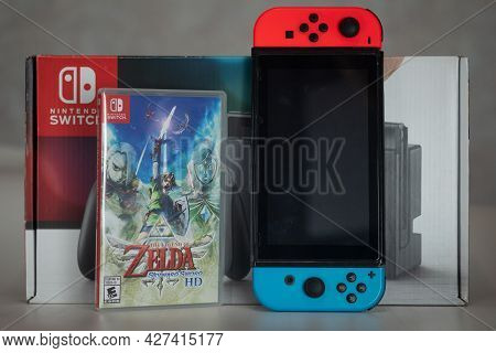 Samut Prakan, Thailand - July 21, 2021: Nintendo Switch Gaming Console With A Box Of Hd Version Of T