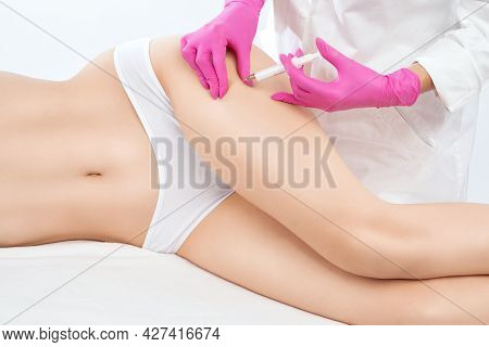 Aesthetic Cosmetologist Makes Lipolytic Injections To Burn Fat On The Thighs, Hips And Body Of A Wom