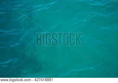 Aerial View Of Aquamarine Sea Surface. Rough Sea Texture. Top View Natural Background Of Rippled Sea