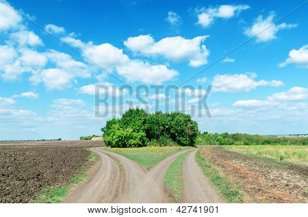 two rural roads to cloudy horizon