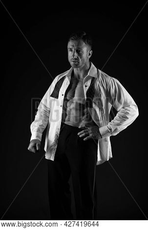 Formal Wear For Special Occasion. Bachelor In Formal Style Dark Background. Sexy Man Show Six Pack A