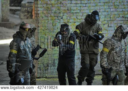 Paintball Players In Full Gear At The Shooting Range, Tournament In St. Petersburg, Russia