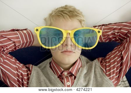 Portrait Of Young Man In Big Glasses