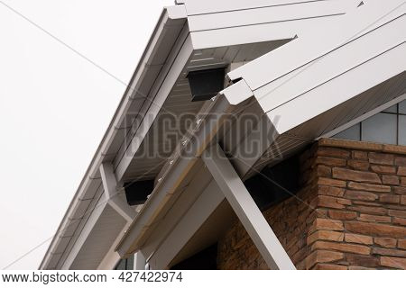 Gutter On The Rooftop Of House Home New Metal