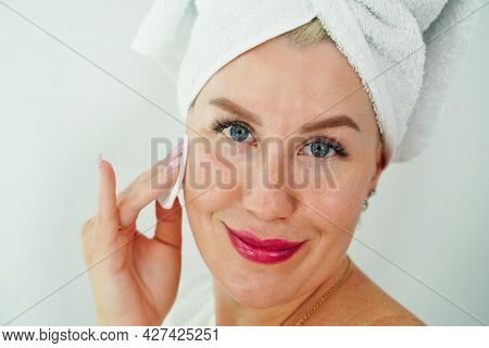 Close Up Beauty Portrait Of Young Attractive Smiling Woman Cleansing Face With Cotton Pad