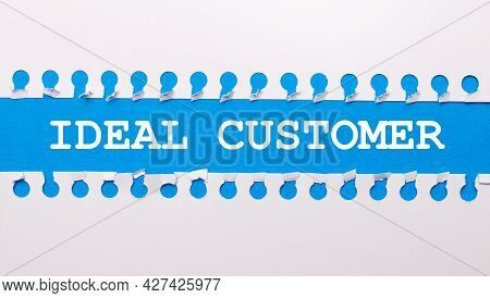 On A Blue Background With Text Ideal Customer Two White Torn Strips Of Paper.