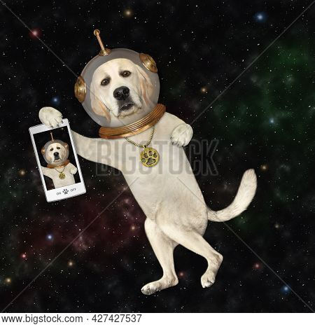 A Dog Labrador Astronaut Wearing A Space Suit With A Smartphone Is In Outer Space.