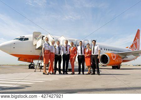 Ukraine, Odessa - July 16, 2021: Pilots And Stewardesses On The Background Of The Passenger Plane Bo