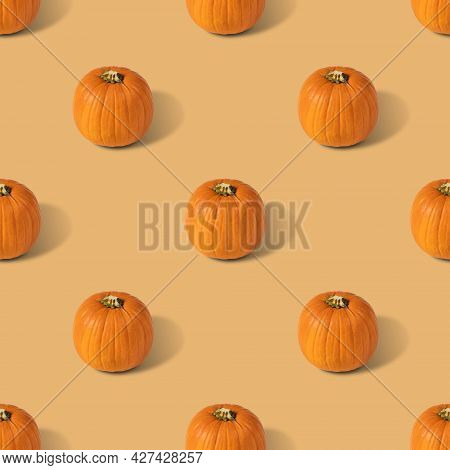 Pumpkin Seamless Pattern On A Beige Background. Vegetable Pattern For The Print. Autumn Abstract Foo