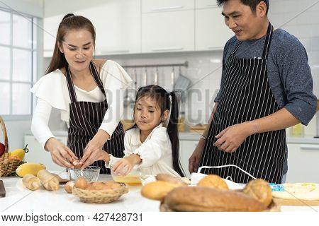 Happy Asia Family With Daughter Making Dough Preparing Baking Cookies, Daughter Help Parent Preparin