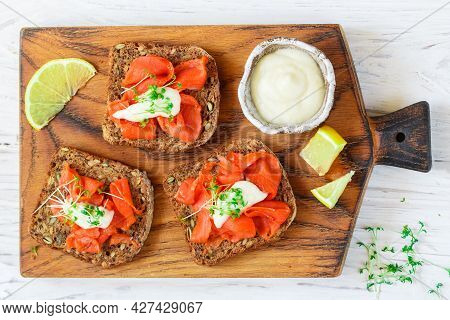 Delicious Sandwiches Made Of Gluten-free Bread With Flax And Sunflower Seeds, Smoked Salmon With Hor