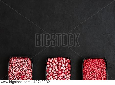 Border With Frozen Berries On A Black Background. Berry Mix. Cranberries, Red Currants And Lingonber
