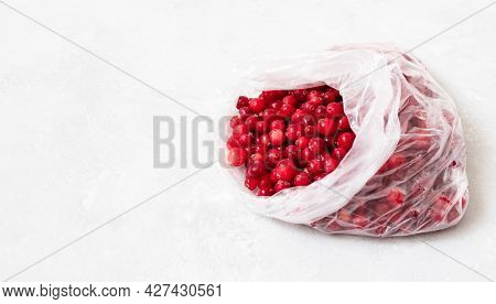 Frozen Cranberries In A Package Close Up. Frozen Berries On A White Background. Homemade Preparation