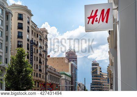 Madrid, Spain - June 18, 2021: Hm Fashion Store Sign In Gran Via Against Cityscape. The Iconic Avenu