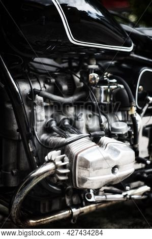 Artistic View Of Old Aluminum Airhead Style, Opposed Twin Engine On Black Antique Motorcycle, With S