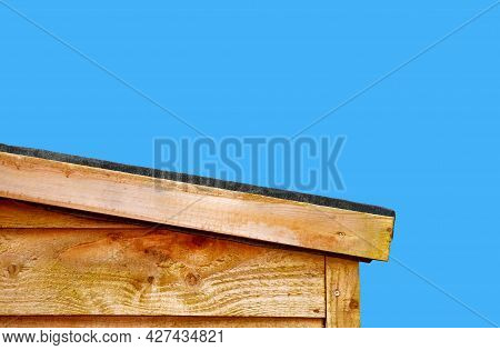 A Slopping Wooden Shed Roof To Let The Rain Water Run Off The Roof, Roofing Felt Is Use To Prevent T