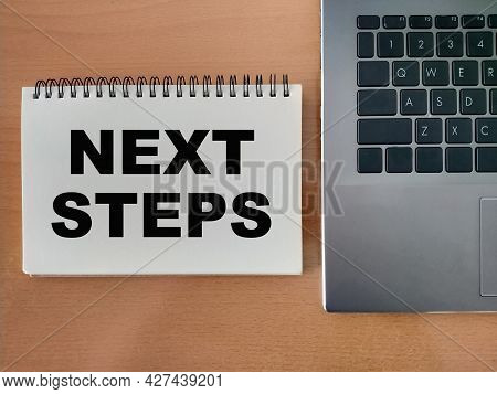The Concept Of The Next Step For Career Growth In The Company. Word - Next Steps, On Notepad With La