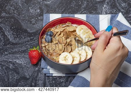 Muesli. Breakfast, Healthy Food And Diet. Muesli With Milk And Fruit In A Plate On A Black Marble To
