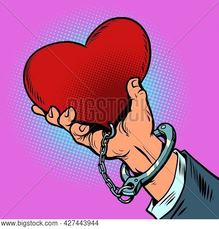 Dependence On Love. The Red Heart Is Handcuffed To The Man Hand. Valentine Day