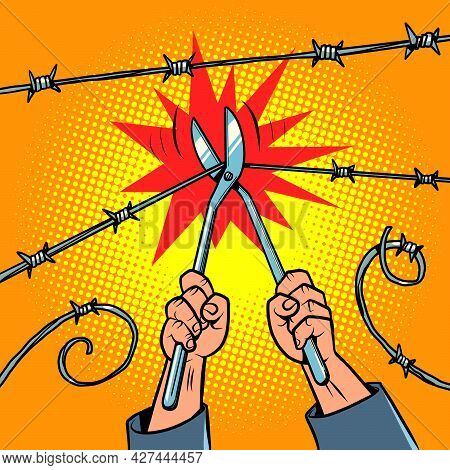 Escape From Prison To Freedom. The Prisoner Cuts The Barbed Wire
