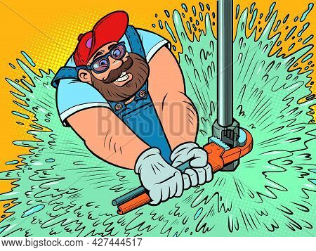 A Male Plumber Repairs The Water Supply. Water Breakthrough