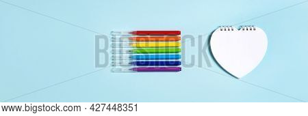 Banner Of Light Blue Color With A Notepad In The Form Of A Heart And Multicolored Markers In Rainbow