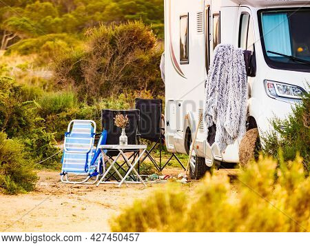 Camping On Sea Shore. Camper Vehicle On Beach, Mediterranean Coast In Spain.