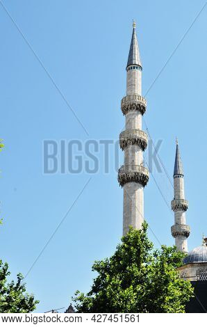 Two Minarets Against The Blue Sky. Minarets In Istanbul. Close-up Of Minarets On A Summer Day.