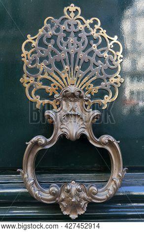 European Vintage Old Metal Wrought Iron Door Knocker. Design Detail. Paris.