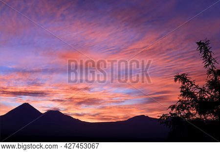 Stunning Sunrise Sky Over The Silhouette Of Mountain Ranges In Northern Chile