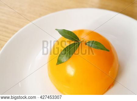 Mouthwatering Vivid Color Mandarin Orange Dome Cake On A White Plate