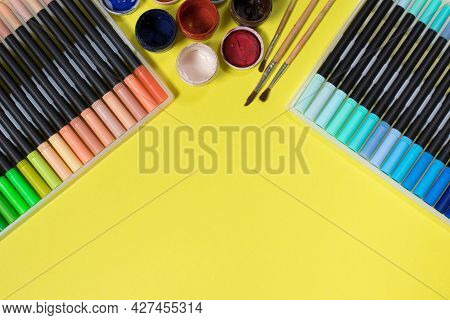 Felt Pens And Paints For Drawing On A Yellow Background With Place For Text. Stationery Store.