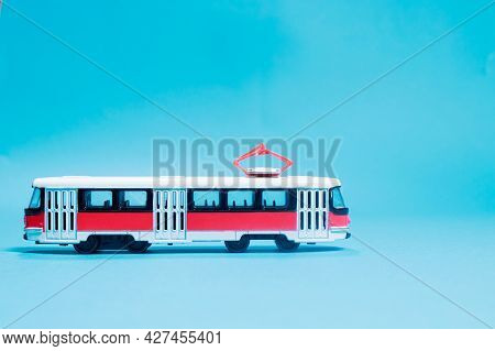 Childrens Toy Red White Tram On A Blue Background Copy Space For Text. Toys For A Toy Store, Cars Fo